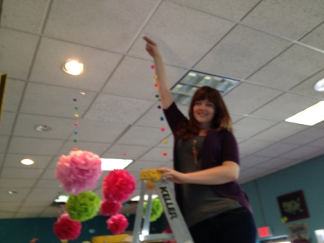 Michelle hanging Pom Poms